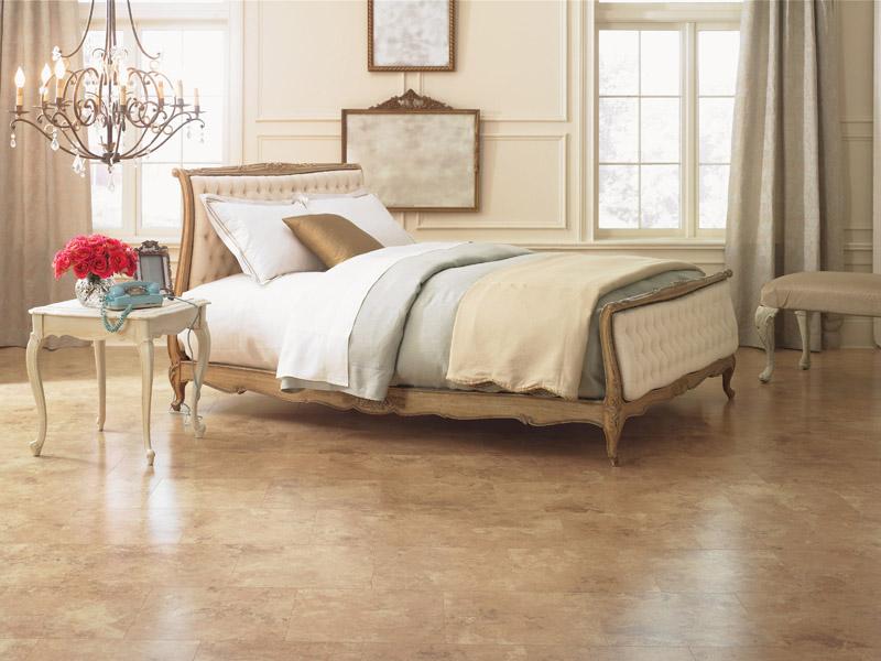 Tan Laminate Floors in Open Bedroom