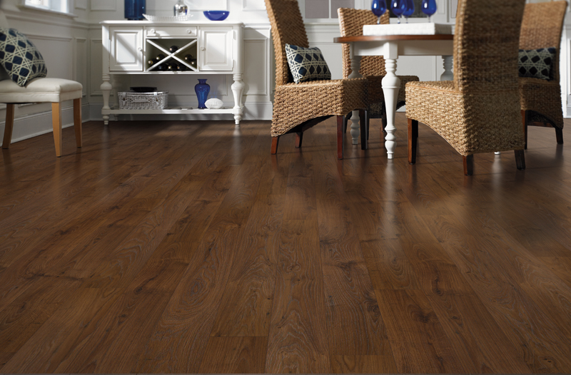 Traditional Dining Room with Laminate Flooring