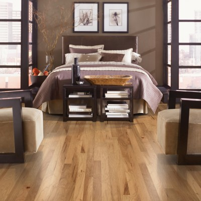 Light Natural Hardwood Floors in Brown and Purplle Themed Bedroom