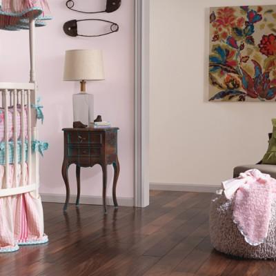 Pink Nursery Room with Dark Natural Hardwood Floors