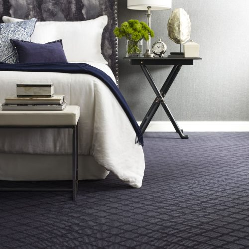 purple bedroom with checkered carpet