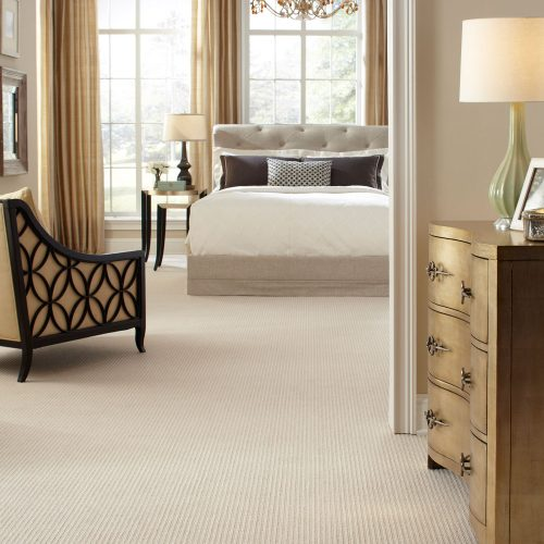 traditional bedroom with cream colored carpet