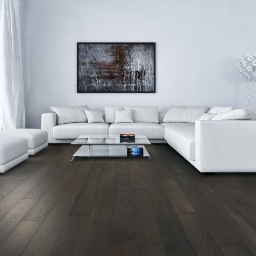 natural hardwood floor and white couch