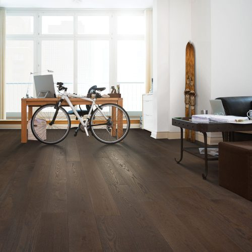 brown hardwood floor in studio apartment