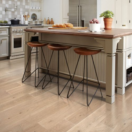 kitchen island and hardwood flooring