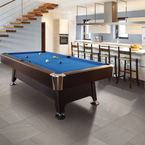 pool table in basement on tile
