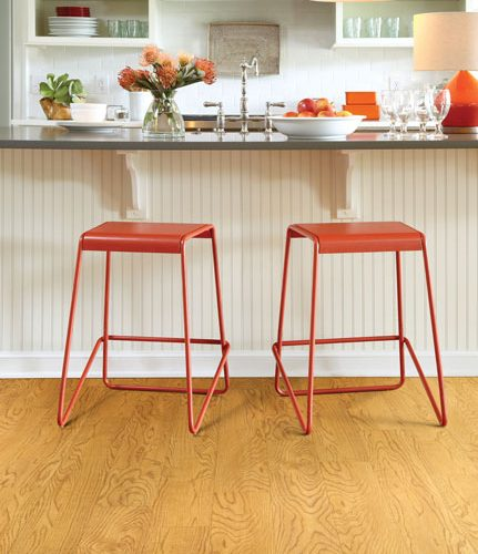 orange stools on tan hardwood floor