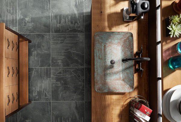 Beautiful ceramic tiles with wood furniture and ceramic sink.